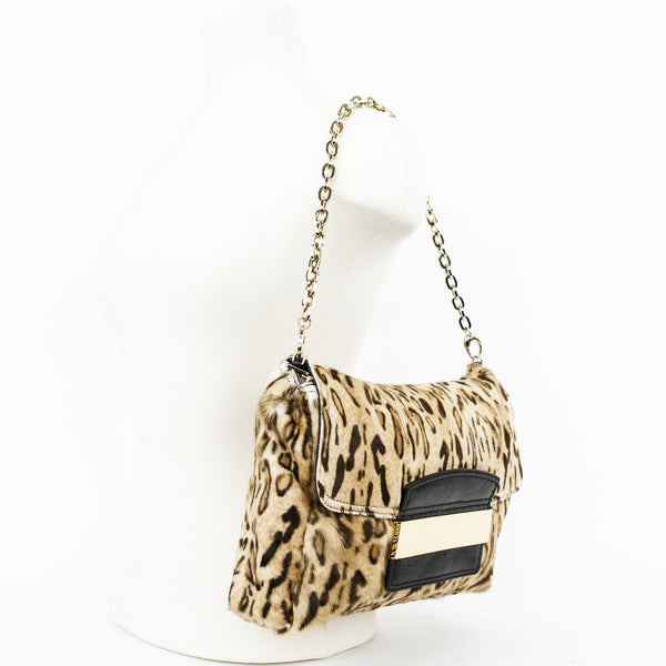 Cheetah print Jimmy Choo pony hair fold over clutch with embossed leather tuck in closure and removable shoulder strap.