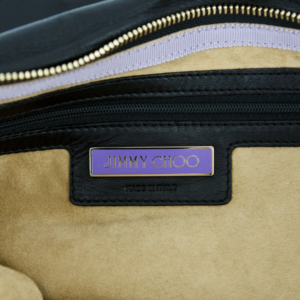 Jimmy Choo purple nameplate on interior