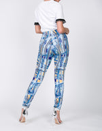 Load image into Gallery viewer, Bright Lites Big City pants leggings with silver chain link print and shades of blue and yellow - Sahvant