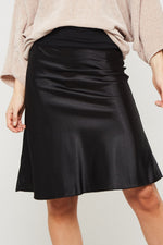 Load image into Gallery viewer, Tea Time knee length black satin skirt with elasticized waistband - Sahvant