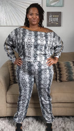 Load image into Gallery viewer, Julissa long sleeve snake print zipper jumpsuit - Sahvant