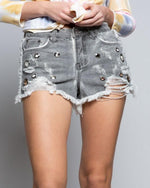 Load image into Gallery viewer, Love on the Rocks light gray raw edge distressed cutoff denim shorts with eyelet details