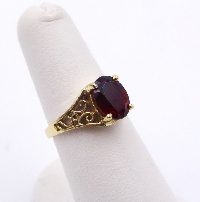Garnet Oval in Feminine Woven Design Ring 14K Yellow Gold