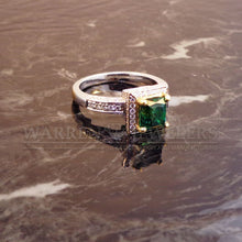 1.30ct Emerald and Diamond Ring at Warren Jewelers