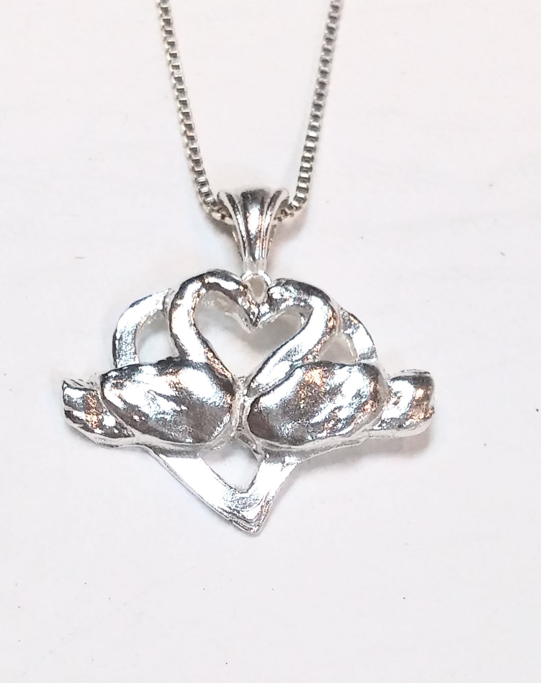 Kissing Swans pendant necklace