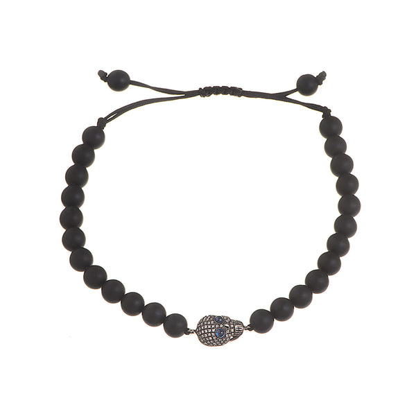 Onyx beads bracelet with a scull pendant with diamonds and two blue sapphires.