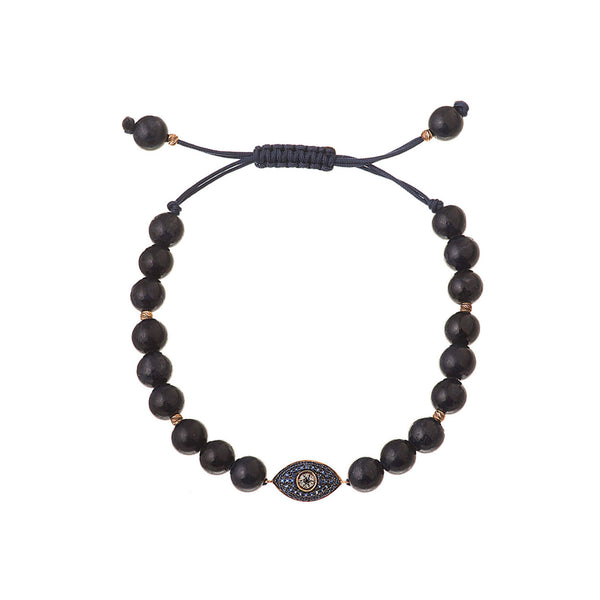 Evil eye bracelet made of blue sapphire. Sapphire beads around the evil eye.