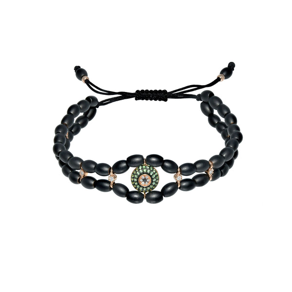 Gold evil eye bracelet with diamonds and tsavorite. Ceramic beads make this bracelet an everyday bracelet to wear.