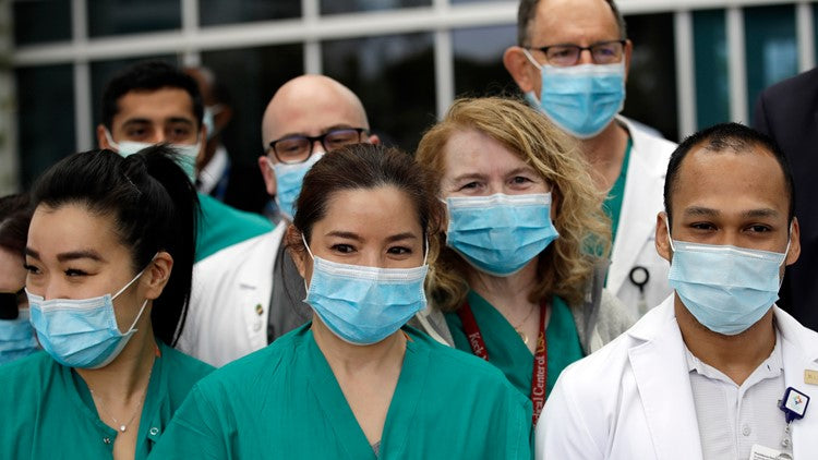 What are the different materials used to produce surgical masks?