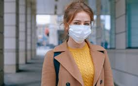 Should you be wearing a surgical mask over your N95 mask?