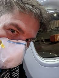Which mask is better for air travel, surgical masks, or the N95 respirators?