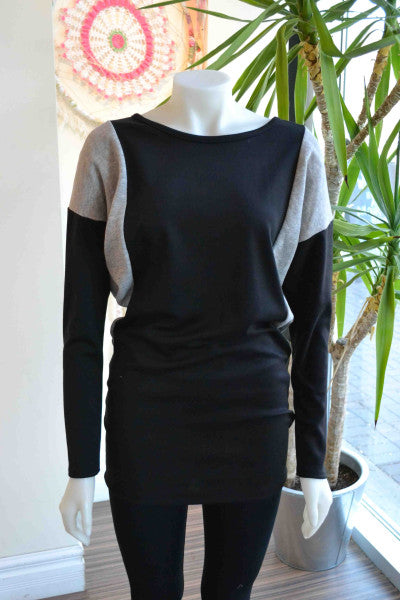This cozy sweater can be worn full length as a dress or pulled up to be sweater length.