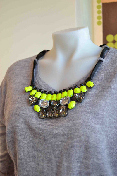 Numph grey pullover with neon necklace from Bamboo Ballroom in Edmonton, Alberta, Canada