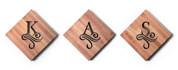 personalized wooden trivets with single initial cut out of the wood