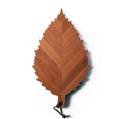 serving board shaped like a cherry tree leaf