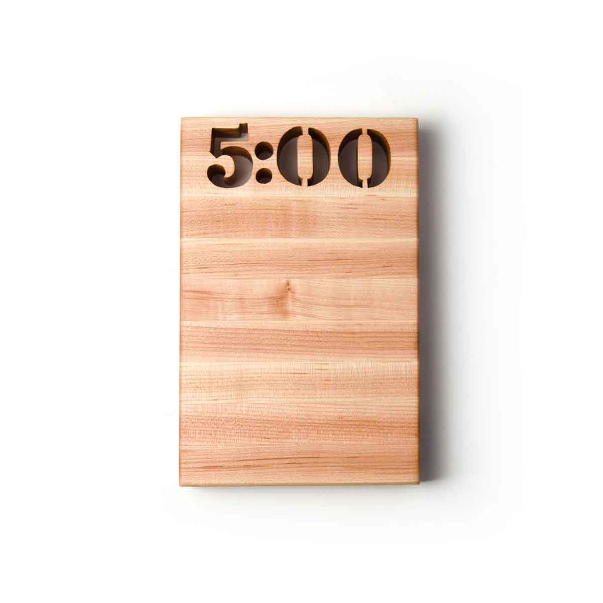 cutting board that says 5oclock - 5 0 0 cut out of the wood