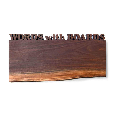Live edge cutting board with words cut out, walnut wood