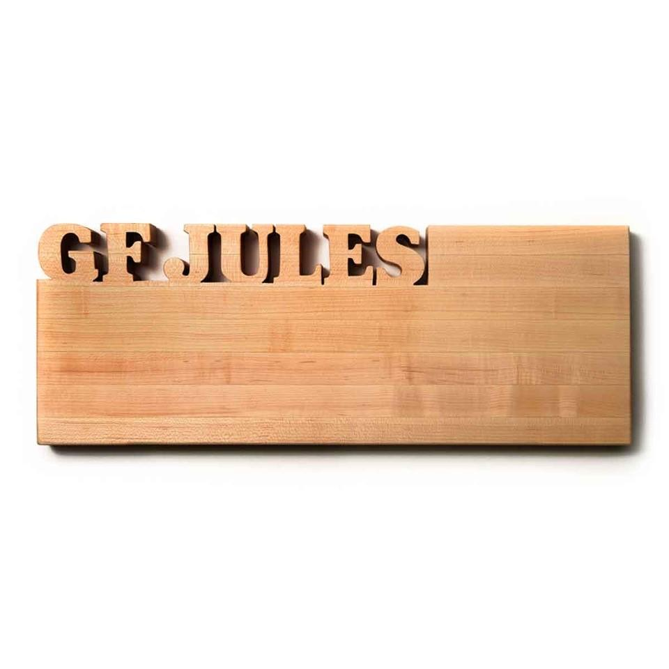 personalized cutting board, long shape, walnut wood, with words carved out