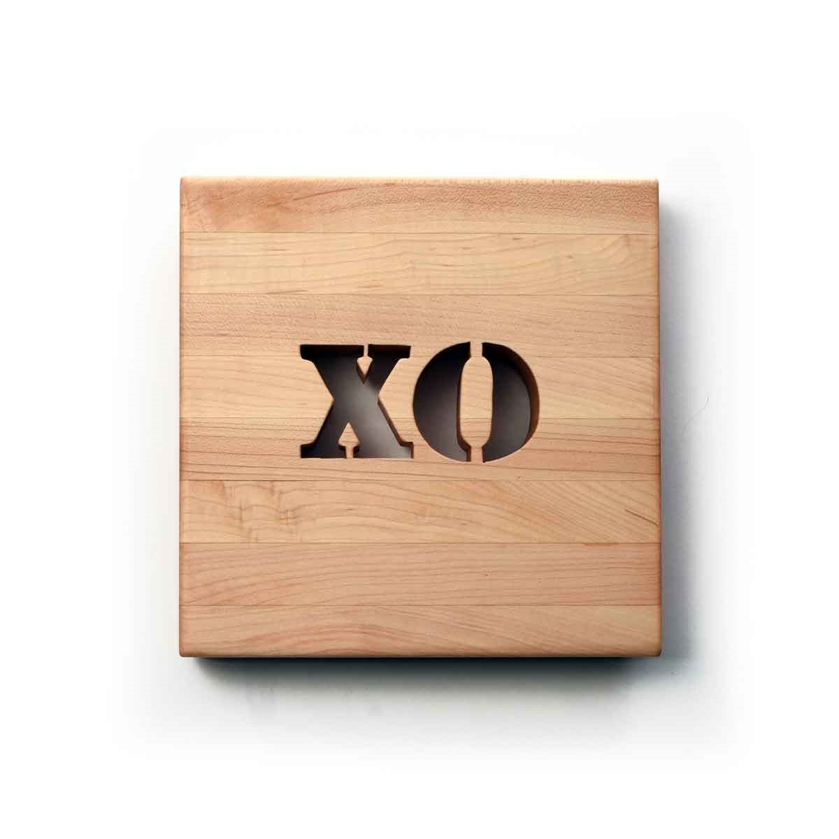 wooden trivet, letters XO cut out