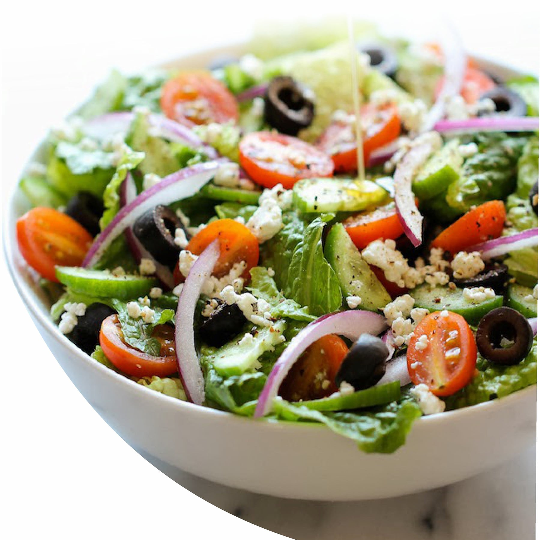 Mediterranean salad with feta cheese, kalamata olives, res onions, tomatoes, and cucumber
