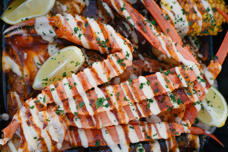 Raider Claw Basket with a cluster of crab legs served with corn and garnishes