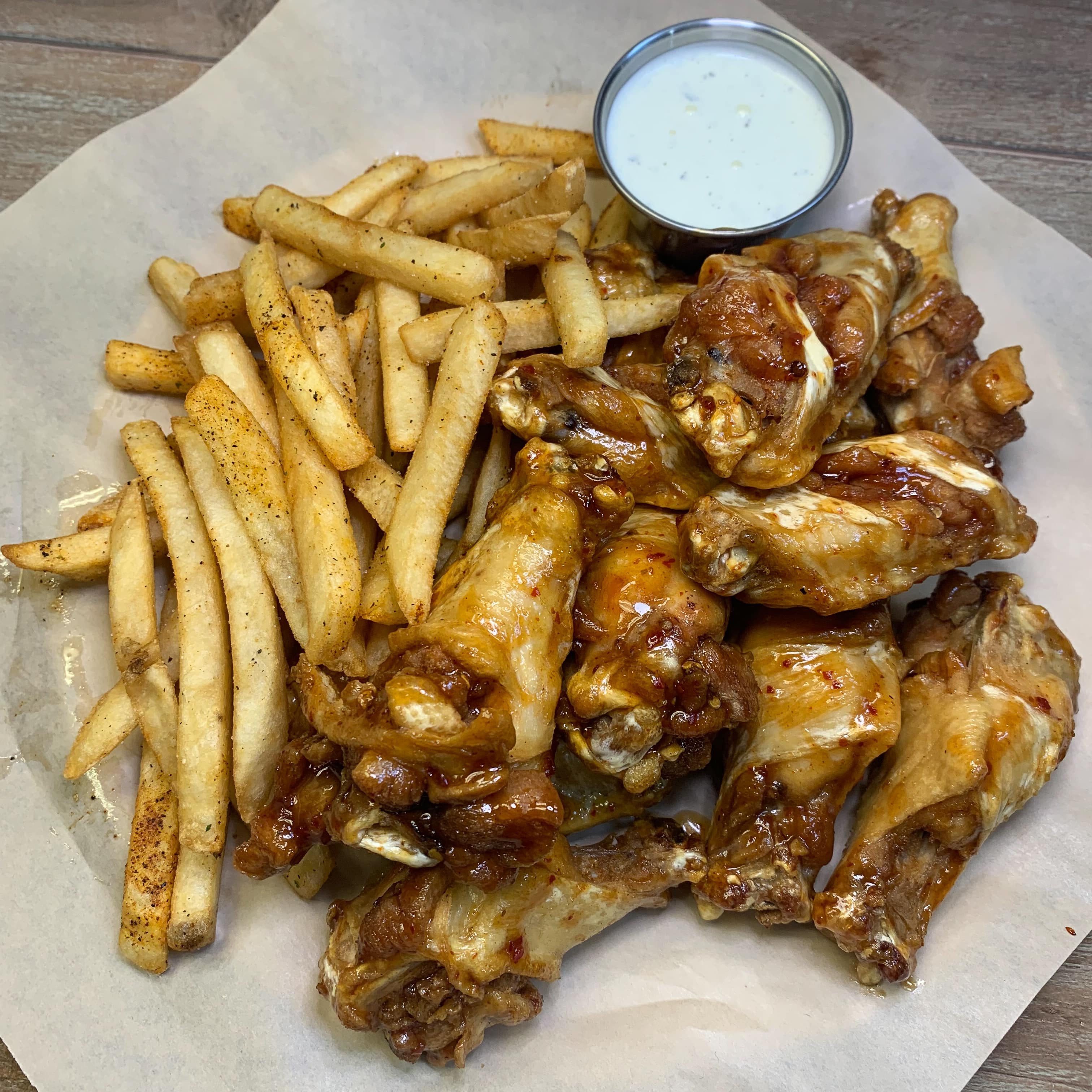 Wings and fries with a side of ranch