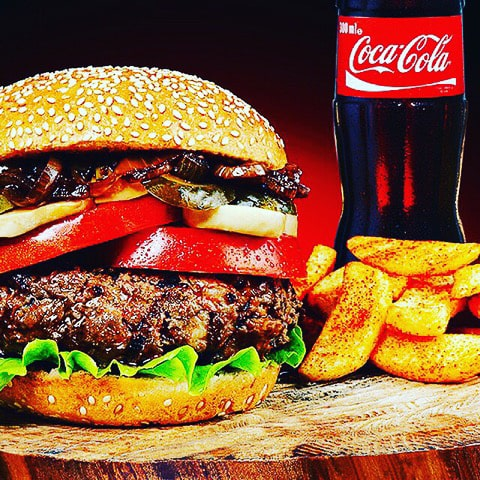 Deluxe cheese burger with tomato, onion, lettuce and mushrooms