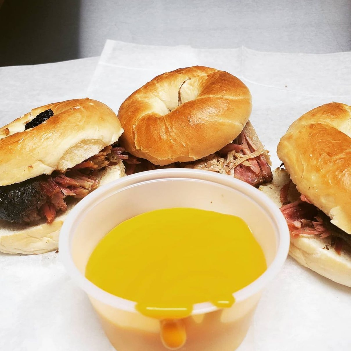 Mini Bagel Sliders with pulled pork and a side of hot cheese
