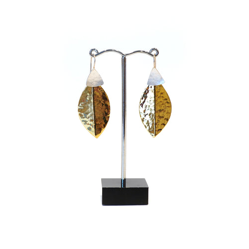 Stylised leaf shape in hammered brass and silver.