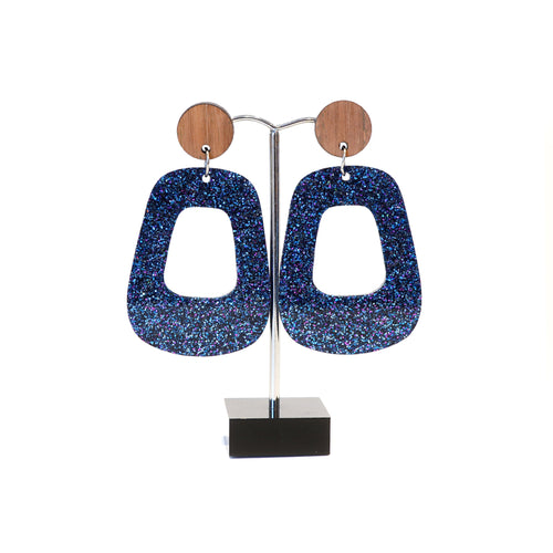 Blue sparkly retro hoops with wooden disc studs.
