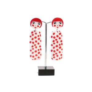 White acrylic with red spots dangle earrings.