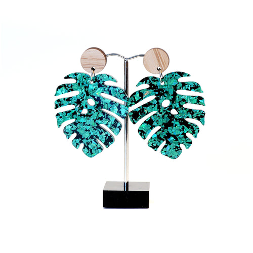 Emerald green and black acrylic leaf shape with wooden disk stud fitting.