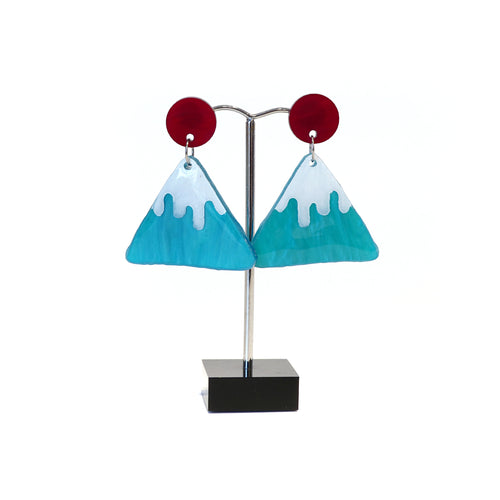 White snow topped blue mountain stylised earrings with red disc studs.