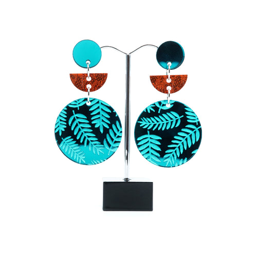 Teal  and orange circle and half moon acrylic statement earrings.