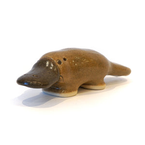 Stylised ceramic platypus collectible ornament.