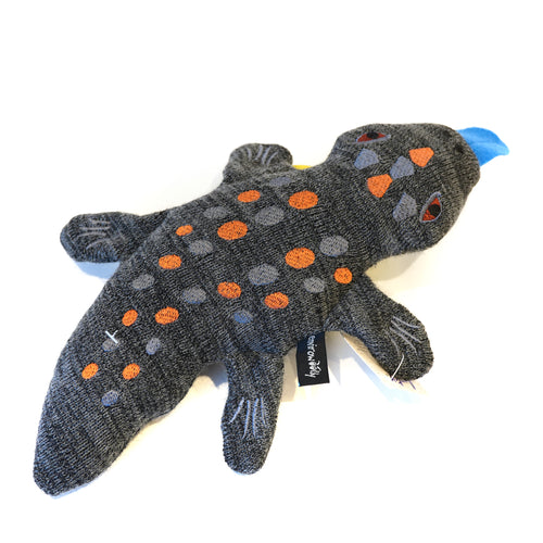 Blue tongue lizard in knitted fabric with embroidered details.