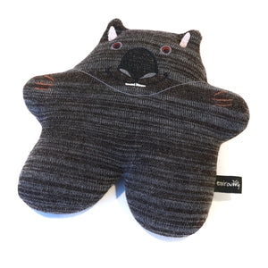 Wombat in knitted fabric with embroidered details.