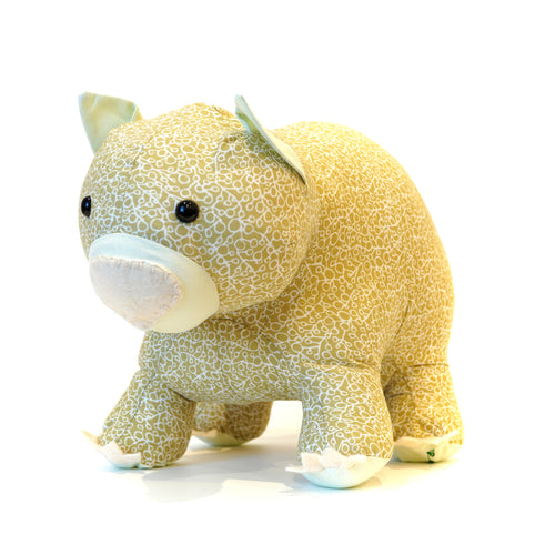 Handmade wombat in light green patterned fabric.