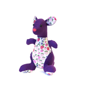 Handmade kangaroo in purple and white floral fabric.