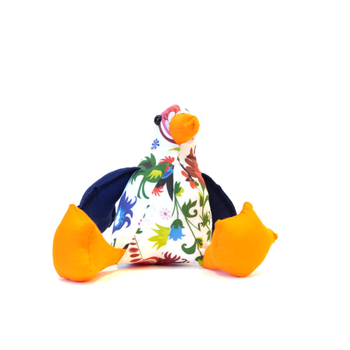 Handmade seagull in white with floral patterns, navy and orange fabric.