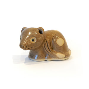 Stylised ceramic spotted quoll collectible ornament.
