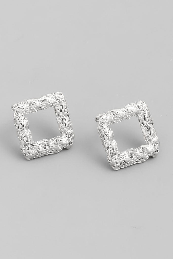 textured square stud earrings.