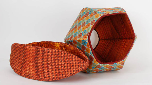 Cat Canoe® modern cat bed made in brown basket weave fabric and Cat Ball® in a metallic tile print