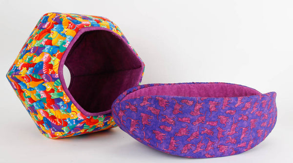 A Cat Ball and Cat Canoe made in bright, cheerful fabrics with a cat theme