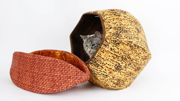 This Cat Ball® cat bed and Cat Canoe® are made in cotton fabrics that look nice together