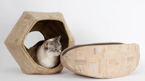 """Coordinating Cat Ball® cat bed and Cat Canoe® in the """"tan stitches"""" fabric"""
