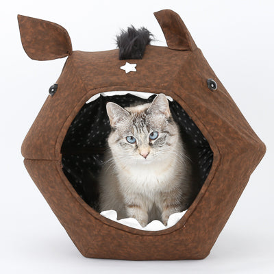 A small cat sits inside the novelty design horse Cat Ball cat bed