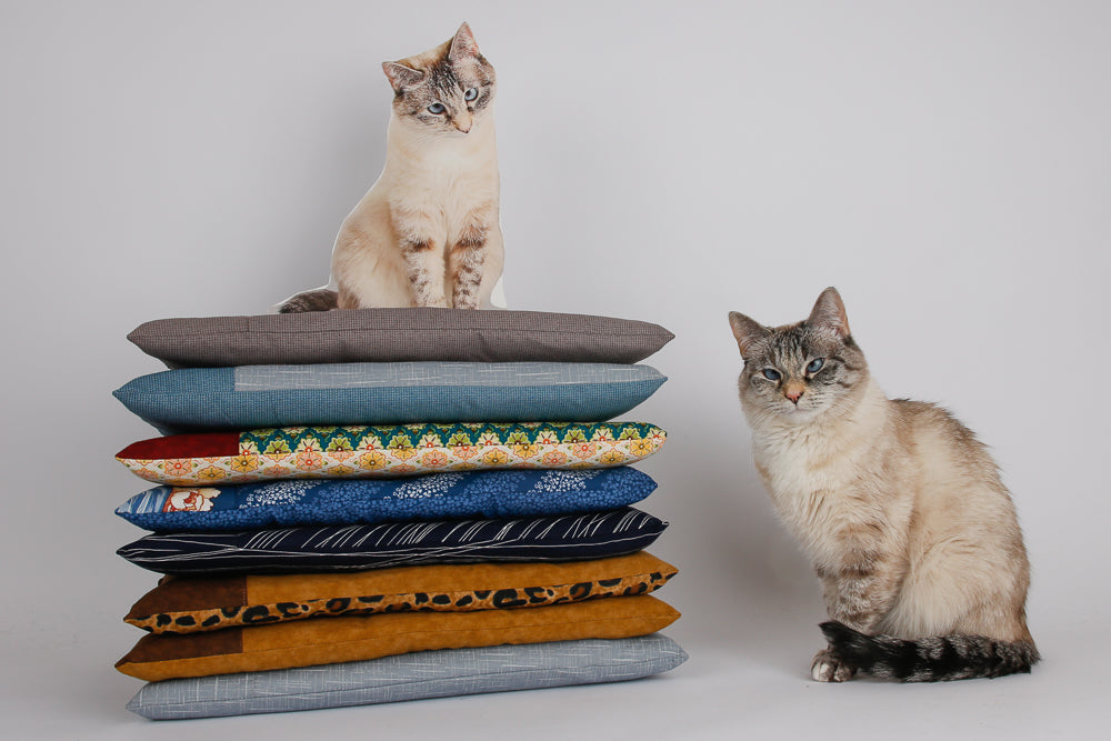 Tink and Flat Tink pose with our cat bed made with a pocket to hold a electric or microwaveable pet bed heater