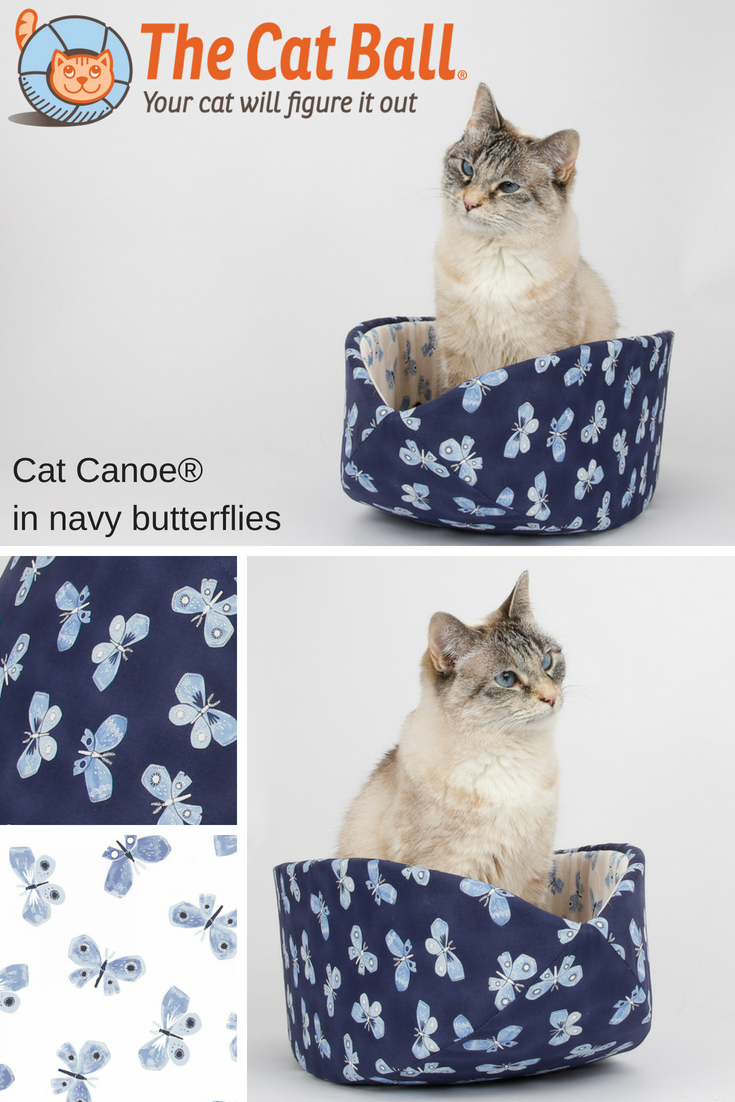 The Cat Canoe cat bed made in navy blue and white butterflies fabric