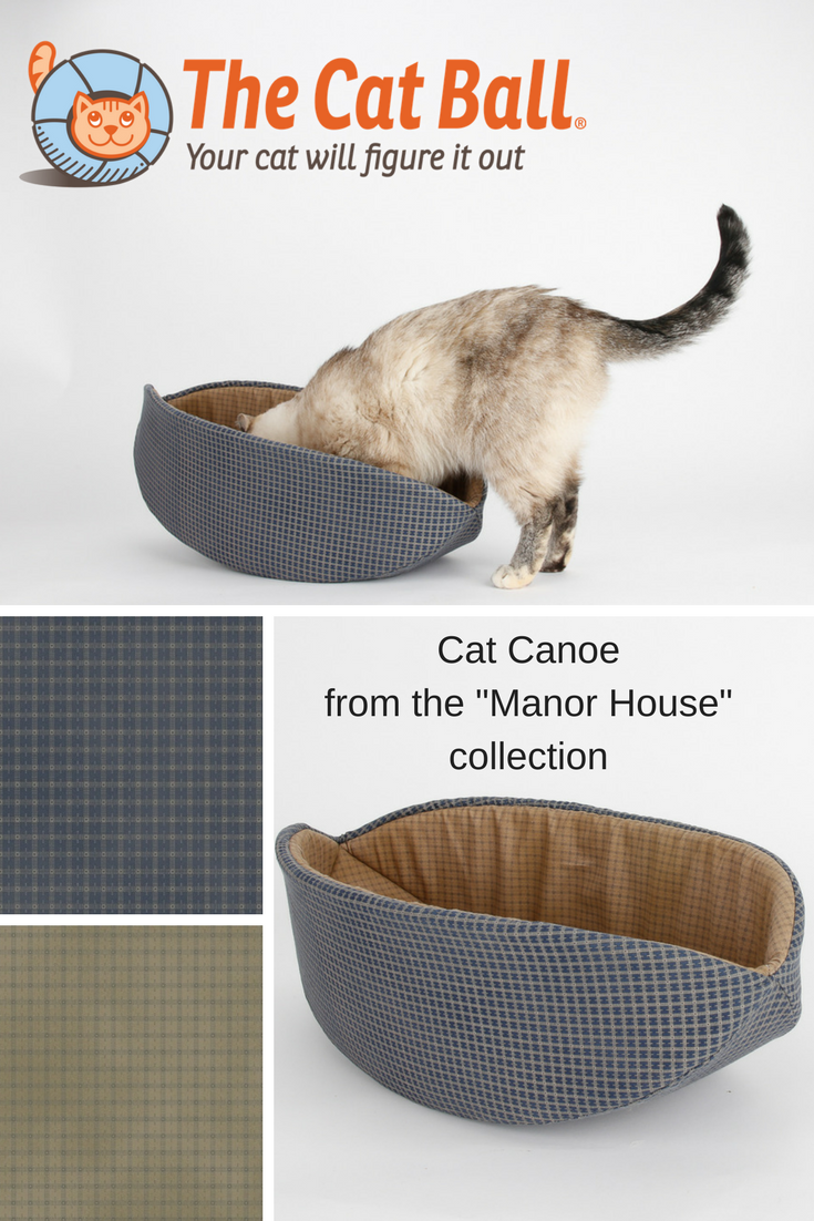 The Cat Canoe is a modern style cat bed, made here in navy blue and tan 100% cotton fabric